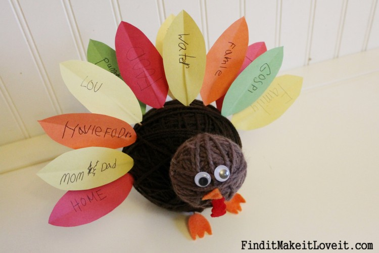 Adorable yarn ball turkey craft with paper feathers
