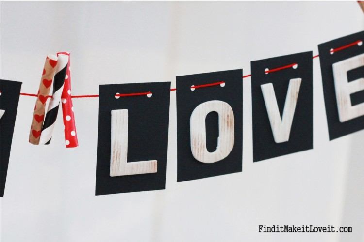 Black card stock, alphabet stickers and embroidery floss make a simple banner!